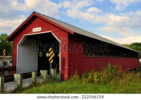 Bennington, Vermont:  The 1889 truss and lattice Paper Mill Covered Bridge over the Walloomsac River - stock photo