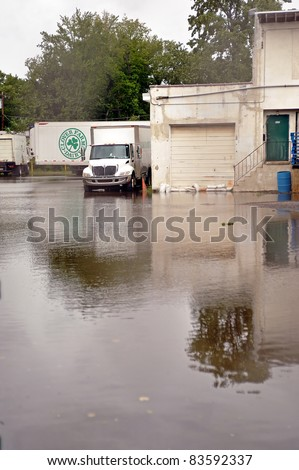 BENSALEM, PA - AUGUST 28: Delivery trucks sit in standing water in a parking lot following Hurricane Irene August 28, 2011 in Bensalem, PA