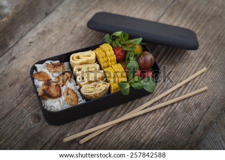 Bento box with different food - stock photo