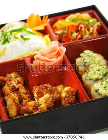 Bento Lunch: Chinese cabbage Salad, Hot Roll, Hot Appetizer and Omelette - stock photo