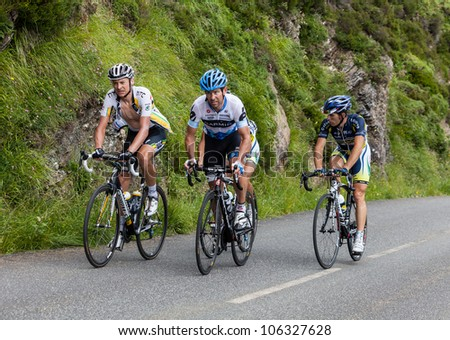 BEOST,FRANCE-JUL 15:Various cyclists from different teams climbing the last kilometers of the category H mountain pass Aubisque, during the 13th stage of Le Tour de France on July 15 2011.