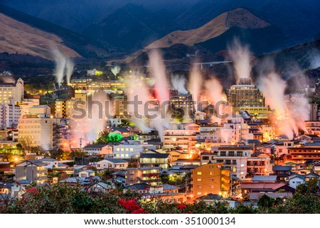 Beppu, Japan cityscape with hot spring bath houses and rising steam. - stock photo