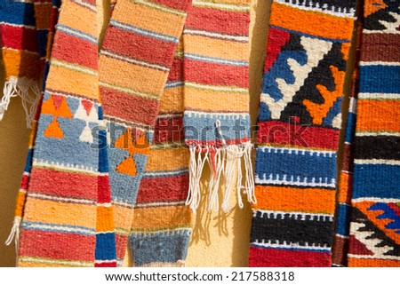Berber moroccan rugs handing at the market of Ait-ben-Haddou, near Ouarzazate in Morocco. - stock photo