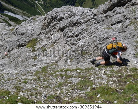 Berchtesgaden, Germany - September 7, 2012 - Climber on his way up in the european alps