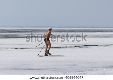 Berdsk, Novosibirsk Oblast, Siberia, Ob River, Russia - April 17, 2016: a skier runs along the ice of the Ob River