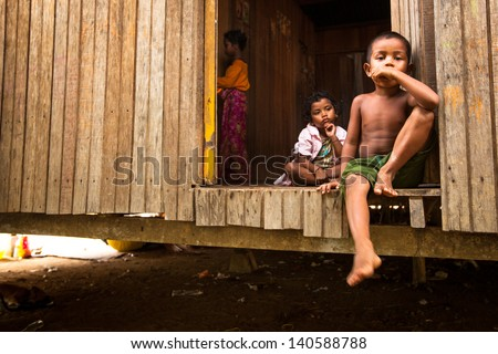 BERDUT, MALAYSIA - APR 8: Unidentified children Orang Asli in his village on Apr 8, 2013 in Berdut, Malaysia. More than 76% of all Orang Asli live below the poverty line, life expectancy -53 years old - stock photo