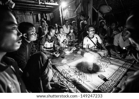 BERDUT, MALAYSIA - APR 8: Unidentified people Orang Asli during a ceremonial dinner  (b/w photo) on Apr 8, 2013 in Berdut, Malaysia. More than 76% of all Orang Asli live below the poverty line.