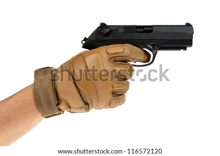 Beretta pistol in hand with tan glove - stock photo
