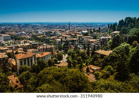 Bergamo is a city in Lombardy, Italy. The foothills of the Bergamo Alps begin immediately north of the town. - stock photo