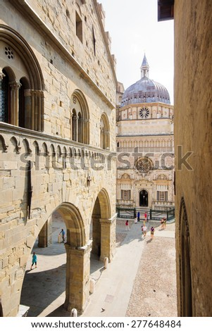 BERGAMO, ITALY - AUGUST 14, 2009: Scene of the Piazza Vecchia, with locals and tourists, in Bergamo, Lombardy, Italy.