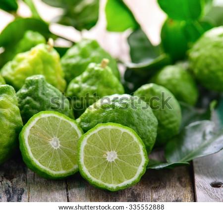 bergamot on wooden table background - stock photo