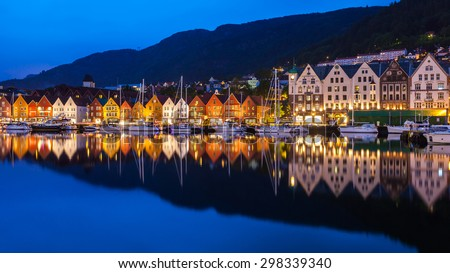 BERGEN, NORWAY - JULY 11: The Bryggen Hanseatic Wharf across the fjord at night, a UNESCO World Heritage site on July 11, 2015, in Bergen, Norway.
