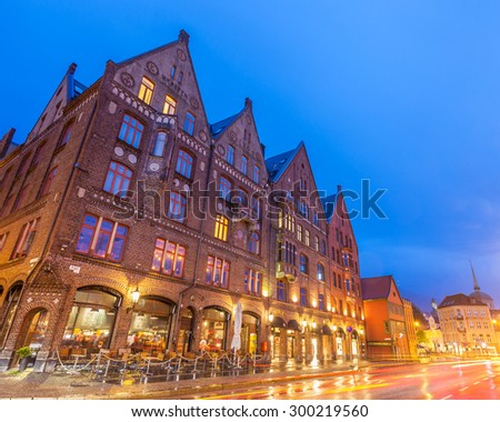 BERGEN, NORWAY - JULY 11: The Bryggen Hanseatic Wharf at night, a UNESCO World Heritage site with shops, hotels, and restaurants on July 11, 2015, in Bergen, Norway. - stock photo