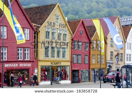 BERGEN, NORWAY - JUNE 09, 2011: Bryggen, row of wooden commercial buildings, dating from year 1360, repeatedly rebuilt after fires, recently in 1955, since 1979 included on  UNESCO World Heritage List