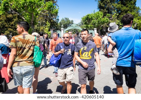 BERKELEY, CA- Apr 16, 2016: Crowds of university alumni, students and community visitors on campus for Cal Day, the annual open house. The main entrance Sather Gate can be seen in the background. - stock photo