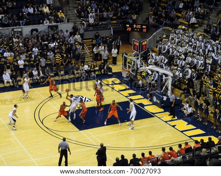 BERKELEY, CA - JANUARY 27: Cal Vs. Oregon State - Cal Player in motion to pass ball at the Haas Pavilion taken January 27, 2011 Berkeley California. - stock photo