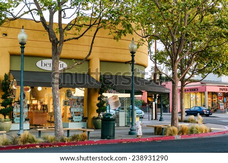 BERKELEY, CA-OCT 21, 2013: Upscale shopping and dining district on leafy 4th Street in West Berkeley attracts visitors and destination shoppers from all over the San Francisco Bay Area. - stock photo