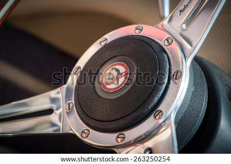 BERKSHIRE, UK - AUGUST 3, 2014: Close up view of a steering wheel of a classic Cobra in August, 2014. - stock photo