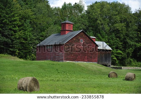 Berkshires, MA, USA -August. 31. 2011: Traditional red barn in Berkshires, state of Massachusetts, USA - stock photo