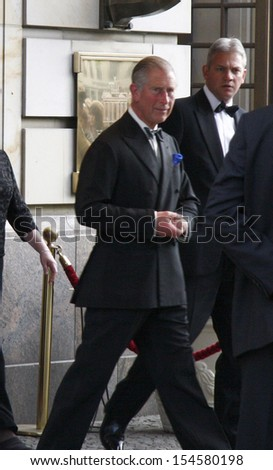 BERLIN-APRIL 29, 2009: Prince Charles (Pronce of Whales) leaves the Hotel Adlon in Berlin Mitte during a journey through Germany by the British Crown Prince and his wife. - stock photo