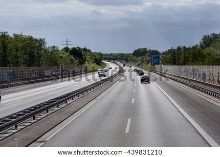 BERLIN AREA - MAY 18: road traffic on a german autobahn on May 18, 2015 in around Berlin , Germany. - stock photo