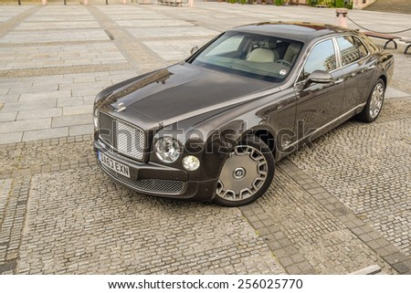BERLIN - AUGUST 2014: Bentley Mulsanne drives along the road during the test drive event for automotive journalists from Eastern Europe. - stock photo