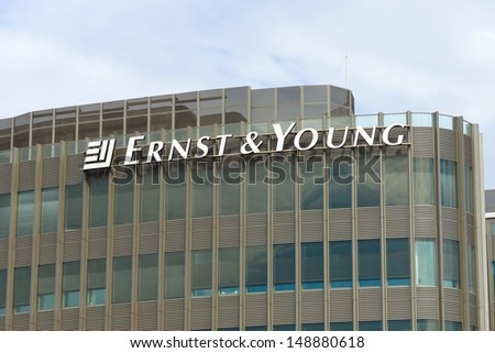 BERLIN - AUGUST 03: The emblem of Ernst & Young. Ernst & Young is a multinational professional services firm and third largest professional services firm in the world, August 03, 2013, Berlin, Germany