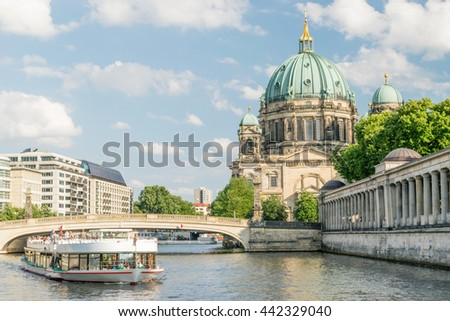 Berlin Cathedral at famous Museum Island with excursion boat river - stock photo