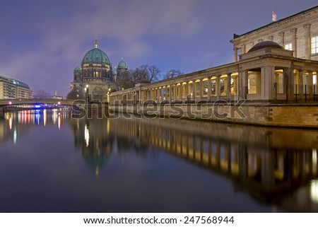 Berlin Cathedral (Berliner Dom) and Museum Island (Museumsinsel) reflected in Spree River at evening, Berlin, Germany, Europe - stock photo