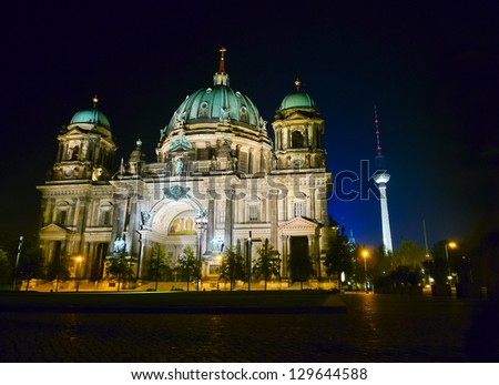 Berlin Cathedral (Berliner Dom) and television tower by night, Germany, Europe - stock photo