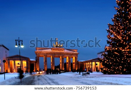 berlin christmas brandenburg gate in winter with snow and christmas tree