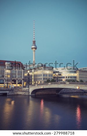 Berlin Cityscape, TV Tower and bridge (Friedrichsbruecke) over river Spree at evening, Berlin Mitte, Germany, Europe, vintage filtered style