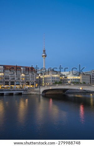 Berlin Cityscape, TV Tower and bridge (Friedrichsbruecke) over river Spree at evening, Berlin Mitte, Germany, Europe - stock photo