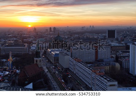 Berlin - Dec. 2016: Beautiful panoramic aerial view over Berlin (Berlin Cathedral - Berliner Dom, City Palace - Stadtschloss, Potsdamer Platz, Bundestag - Reichstag) with romantic colorful sunset.