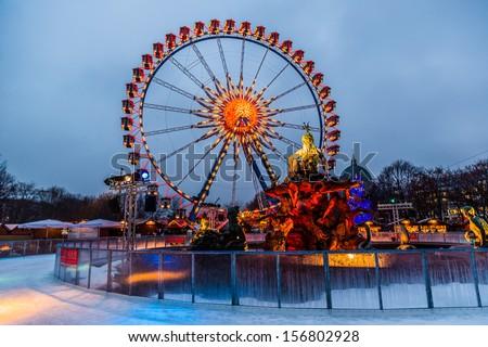 BERLIN,-DECEMBER 7:Berlin shines in a festive blaze of lights in the period before Christmas on December 7, 2012. Christmas wheel at Alexanderplatz in Berlin, Germany. - stock photo