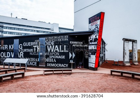 BERLIN, 14 December: Checkpoint Charlie. Former bordercross in Berlin on 14 December, 2014. Berlin Wall crossing point between East and West Berlin during the Cold War. BERLIN, GERMANY - stock photo