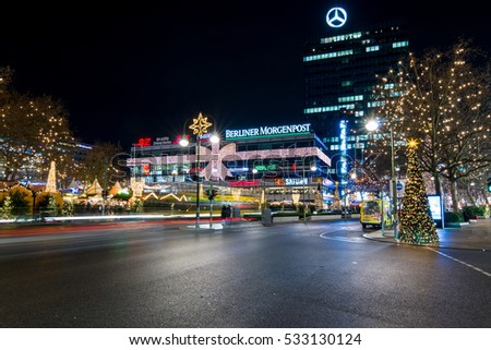 BERLIN - DECEMBER 07, 2016: The famous shopping street of West Berlin, Kurfurstendamm in the Christmas illuminations. Christmas market on Breitscheidplatz.