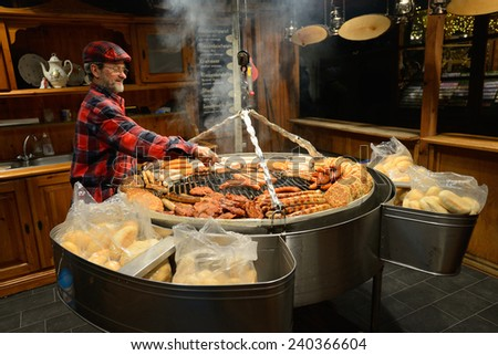 BERLIN - DECEMBER 26: Unidentified people trades food in annual traditional Christmas fair in Alexanderplatz on 26 December 2014 in Berlin, Germany. - stock photo