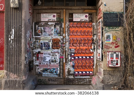 "BERLIN, FEBRUARY 24: A door with old posters in the ""Schololade"" haus in the Ackestrasse in Berlin Mitte on February 24, 2016."