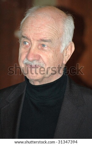 "BERLIN - FEBRUARY 12: German actor Armin Mueller-Stahl smiles on an official reception of jury during ""Berlinale 2006"" film fest during the  February 12, 2006 in Berlin."