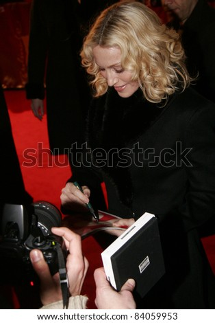 "BERLIN - FEBRUARY 13: Madonna attends the ""Filth and Wisdom"" premiere at the 58th Berlinale Film Festival at the Zoo Palast on February 13, 2008 in Berlin, Germany. - stock photo"