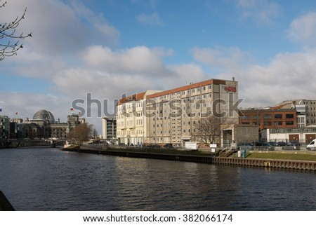 BERLIN, FEBRUARY 24: Original GDR building next to a construction lot in Schiffbauerdamm next to the Spree river and the Reichstag in Berlin on February 24, 2016.