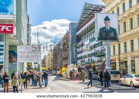 BERLIN, GERMANY - APRIL 20, 2016: Checkpoint Charlie - former border cross in Berlin. Berlin Wall crossing point between East and West Berlin during the Cold War. - stock photo