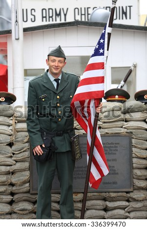 Berlin, Germany - April 27, 2015: Checkpoint Charlie was the name given by the Western Allies to the best-known Berlin Wall crossing point between East Berlin and West Berlin during the Cold War. - stock photo
