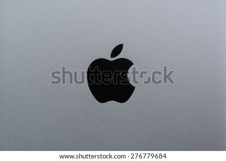 BERLIN, GERMANY - APRIL 26, 2015: close up of backside of a space grey Apple iPhone with Apple logo on apr 26 in Berlin, Germany - stock photo