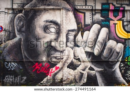 BERLIN, GERMANY - 30 April 2015: Graffiti Warschauer Strasse, Friedrichshain, Berlinl. Berlin on April 30, 2015. Berlin, Germany - stock photo