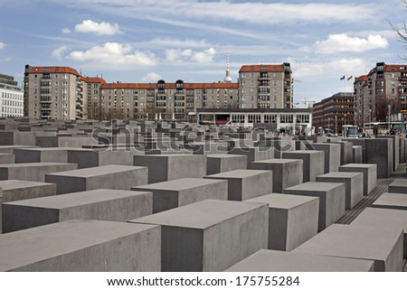 BERLIN, GERMANY - APRIL 14: Memorial to the Murdered Jews of Europe (2711 concrete pillars) designated by P. Eisenman and B. Happold is located near Brandenburg Gate, in Berlin's heart. APRIL 14, 2013 - stock photo