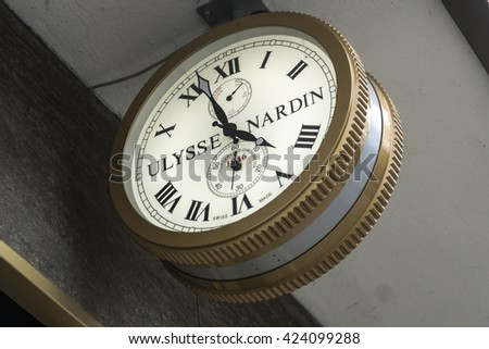 Berlin, Germany - April 26, 2016: Sign of the luxury Ulysse Nardin brand, written in a clock. Founded in 1846 in Switzerland, the Ulysse Nardin company makes chronometers and watches