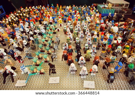 BERLIN, GERMANY - AUG 30: Army of small toy heroes from Lego, for sale on Mauerpark flea market on August 30, 2015. Urban area of Berlin comprised 4 mill. people, 7th most populous in EU - stock photo