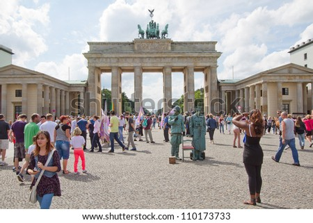 BERLIN, GERMANY, AUG 6 - Tourists in front of Brandenburg Tor, Berlin. It is a former city gate, rebuilt in the late 18th century and now one of the most known landmarks of Berlin. August 6, 2012.